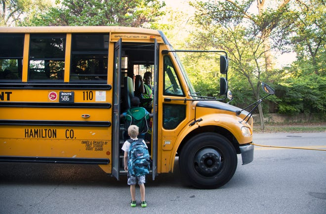 Clark Hand, first grader, boards the First Student bus behind his friend Anthony Beamon, third grader on May Street, just south of William Howard Taft in Walnut Hills. They attend Sands Montessori Elementary School in Mount Washington. This is the fourth week of school for Cincinnati Public and his mom, Kelly Hand, said the bus hasn't been on time yet. It's causing anxiety for Clark to be late for school. Every day he asks her to drive him instead.