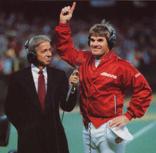 SEPTEMBER 11, 1985: Reds' radio broadcaster Marty Brennaman and Pete Rose listen as President Ronald Reagan phones his congratulations