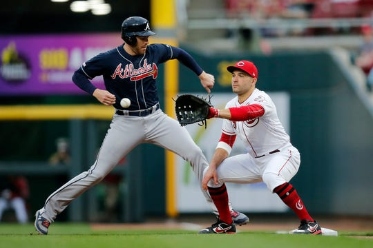Atlanta Braves first baseman Freddie Freeman (5) steps back to first against Cincinnati Reds first baseman Joey Votto (19) on pick off attempt in the third inning of the MLB National League game between the Cincinnati Reds and the Atlanta Braves at Great American Ball Park in downtown Cincinnati on Wednesday, April 24, 2019