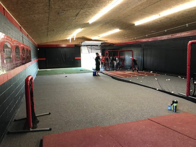 Middle school students practice batting in the Rossview campus indoor batting practice facility on Sept. 9, 2019.