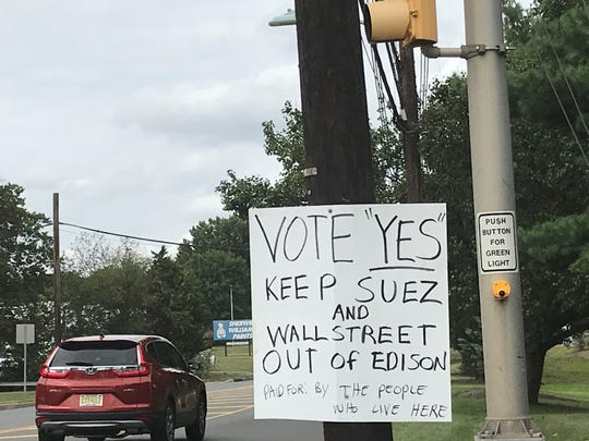 One of several signs in Edison aim for the township to retain control of its sewer systems in regard to a Sept. 10 special election.