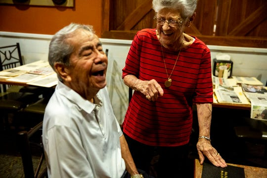 Mary Grant, 92, laughs with Roy Garcia, 96, both members of the West Des Moines Valley High School class of 1944, after presenting him with the diploma he had yet to receive after being sent to the South Pacific to fight in the Philippines during World War II, on Monday, Sept. 9, 2019, in Urbandale. Grant, Garcia, and another classmate Jim Faulkner were celebrating their 75th class reunion.