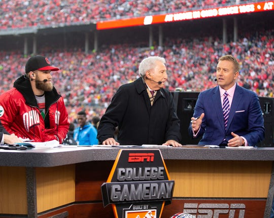 Celebrity picker Bryce Harper, Lee Corso, and Kirk Herbstreit on the set of ESPN College Gameday before the game between the Michigan Wolverines and Ohio State Buckeyes at Ohio Stadium.