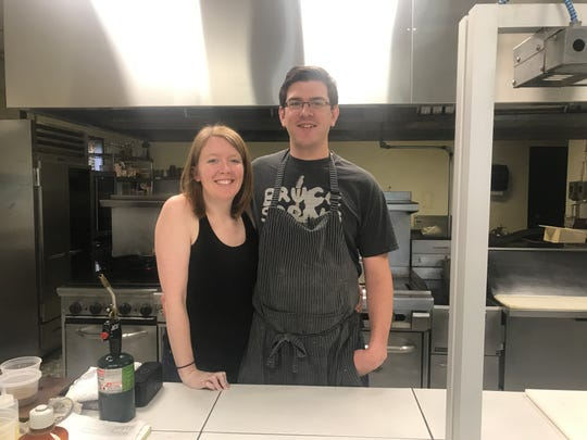 Chef Jacob Demars and Kathleen McGuire stand in the open kitchen of R I Restaurant in Windsor Heights.