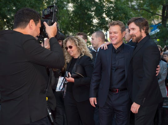 "Actors Matt Damon, second right, and Christian Bale, right, pose for photographs as they arrive for the premiere of the film ""Ford v Ferrari"" at the Toronto International Film Festival on Monday, Sept. 9, 2019. (Nathan Denette/The Canadian Press via AP)"