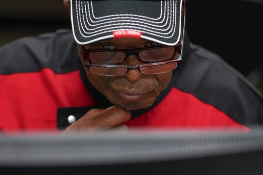 Lamarr Fox of Detroit fills out an application for FCA jobs at the new Mack assembly plant at  the Northwest Activity Center in Detroit on Tuesday, Sept. 10, 2019.