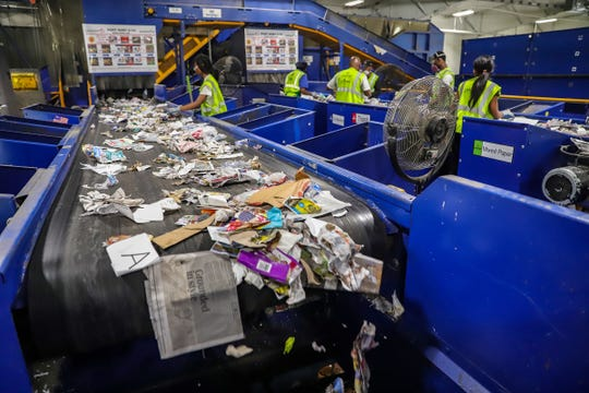 Workers with Leadpoint sort recycling at different stages at the SOCRRA material recovery facility in Troy,  Aug. 14, 2019.  SOCRRA serves 12 municipalities in southeast Michigan.