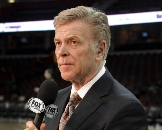 In this Feb. 19, 2014, photo, longtime sportscaster and announcer Fred McLeod is shown at a Cleveland Cavaliers game in Cleveland. McLeod has died. He was 67. The Cavaliers said McLeod died suddenly Monday night, Sept. 9, 2019.