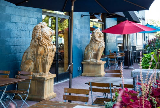 Outdoor patio seating at the Three Cats restaurant inside the Show at Leon & Lulu in Clawson.