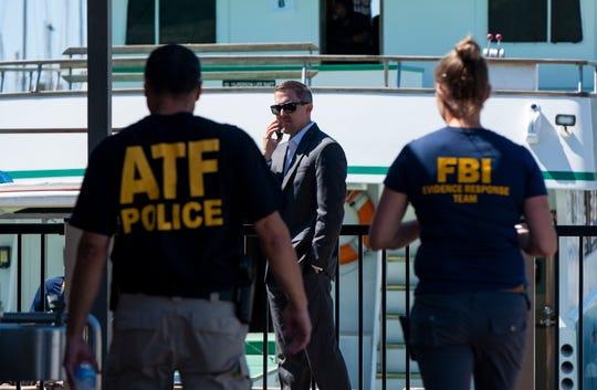 Authorities investigate the Truth Aquatics office in Santa Barbara, Calif., on Sunday.