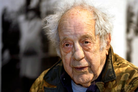 In this Jan. 28, 2016, file photo, photographer and filmmaker Robert Frank appears at the opening his exhibition at New York University's Tisch School of the Arts. Frank, one of the 20th century's greatest photographers, has died at age 94.