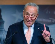 In this Aug. 1, 2019 file photo, Senate Minority Leader Chuck Schumer, D-N.Y., talks to reporters at the Capitol in Washington. The Senate's top Democrat intends to force a vote on blocking President Donald Trump from using special emergency powers to transfer money from military base construction projects like new schools to pay for new fences along the U.S.-Mexico border.