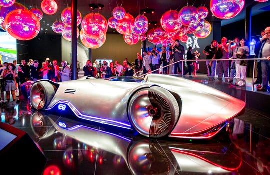 """The Mercedes concept car """"EQ Silver Arrow"""" is surrounded by media people at the IAA Auto Show in Frankfurt, Germany, Monday, Sept. 9, 2019."""