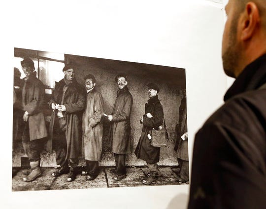 "In this Jan. 28, 2016 file photo, a man looks at a photograph by Robert Frank at the opening of the exhibition featuring Frank's work, ""Robert Frank: Books and Films, 1947-2016,"" at New York University's Tisch School of the Arts in New York."