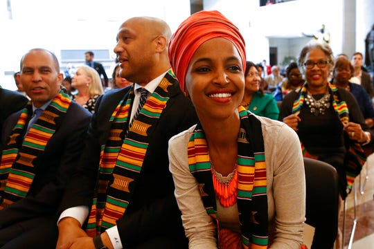 Rep. Ilhan Omar, D-Minn., attends a ceremony to commemorate the 400th anniversary of the first recorded arrival of enslaved African people in America, Tuesday, Sept. 10, 2019, on Capitol Hill in Washington.