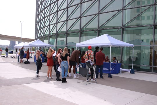 """Contestants auditioned before judges in groups of four at the """"American Idol"""" open call auditions in Detroit on Tuesday."""