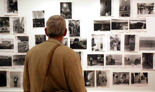 "In this May 18, 2009 file photo, a man looks at prints from the Looking In: Robert Frank's ""The Americans"" exhibit at the Museum of Modern Art in San Francisco."