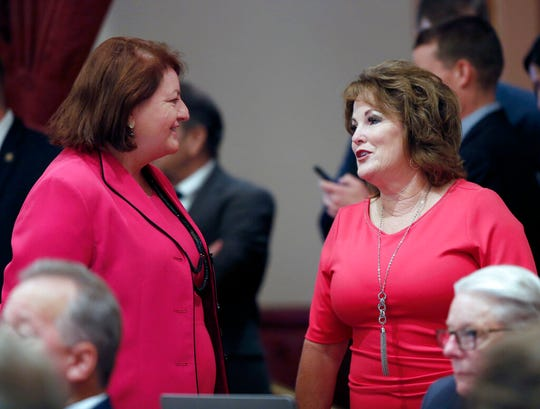 State Senate President Pro Tem Toni Atkins, of San Diego, left, and Senate Republican Leader Shannon Grove, of Bakersfield right, talk during the Senate session Friday, Sept. 6, 2019. Atkins authored California bill SB 1 which would preserve the state's federal standards on the environment, public health and worker safety that were in place on Jan. 19, 2017 – the day before Donald Trump took office.