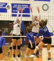 Taylor Malone (10) of Horseheads spikes the ball as Elmira's Caroline Barr (10) and Morgan Gentile (17) for the block Sept. 9, 2019 at Horseheads Middle School. Also pictured is Horseheads' Cameron Hilliard (11).