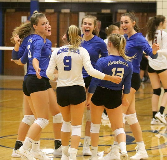 Horseheads players celebrate a point during a 3-0 win over Elmira on Sept. 9, 2019 at Horseheads Middle School.