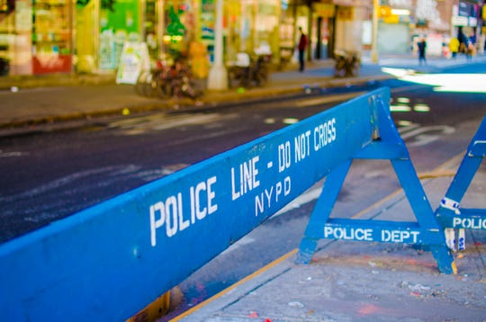 A Police Line barrier in Chinatown, NYC set up by the NYPD
