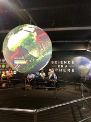 Science on a Sphere can display the Earth's global surface temperature from both the past and the present.