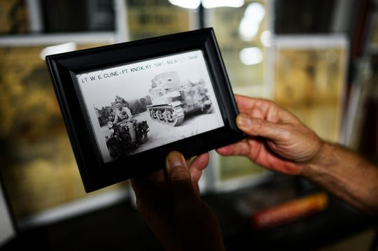 Bill Cline shows a photograph of his father, Lt. W.E. Cline, which is on display at the U.S. Military History Museum & Education Center Tuesday, Sept. 10, 2019.