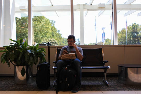 Florian Harr waits for his flight at Greenville-Spartanburg International Airport, Monday, Sept. 9, 2019.