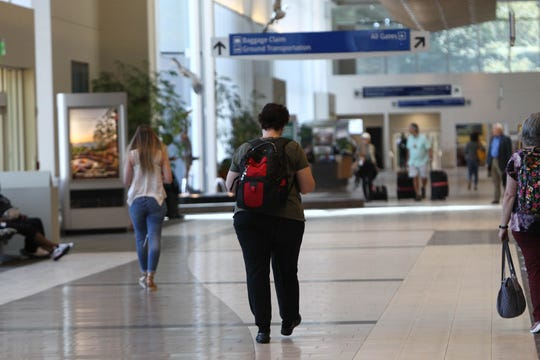 Travelers check in baggage and head to security at Greenville-Spartanburg International Airport, Monday, Sept. 9, 2019.