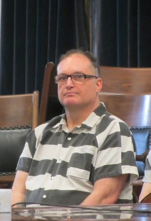 Gene Lynn Watson awaits a status hearing in district court Tuesday, Sept. 10, 2019.