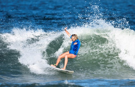 Guam's Alison Bowman carves a path through a wave during her heat at the ISA World Surfing Championships Sept. 9 in Japan.