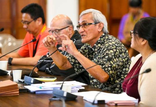 Guam Power Authority General Manager John Benavente describes the amount of land needed to generate enough solar power to serve island consumers for a day, as he addresses senators during an oversight hearing at the Guam Congress Building in Hagåtña on Sept. 10, 2019. Benavente testified that it would require about 3,400 acres of land to produce the electricity but also touched upon the necessity of relying on power stored in batteries during the time that sunlight is not available.