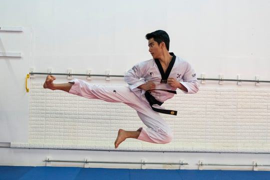 "Guam Taekwondo Center blackbelt Joseph ""Jed"" Caluag executes a flying side kick."
