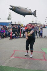 Jessica Fithen competes in a Strongman competition in Palmer, Alaska. She threw a 50-pound silicone salmon 14 feet, 1 inch, for the win.
