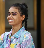 "Megan Suri, playing the lead character Bindu, smiles between scenes on the set of ""The MisEducation of Bindu"" on July 17, 2018, at the old Broad Ripple High School."