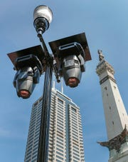 LED moving light installed light poles around Monument Circle. Crews from Dodd Technologies work to install lights, speakers and projectors on and around Monument Circle on Tuesday, Sept. 10, 2019.
