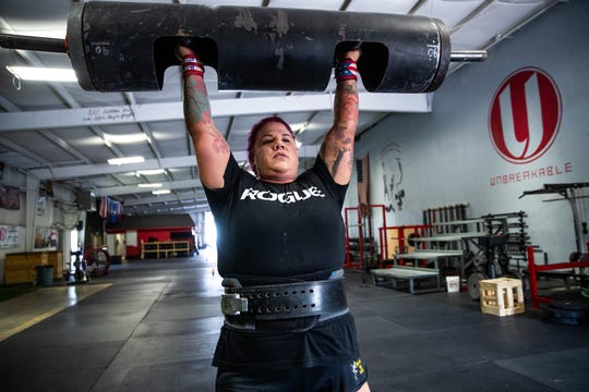 Jessica Fithen log presses 140 pounds at her gym, Unbreakable Athletics, in Plainfield, Ind., on Tuesday, Sept. 10, 2019. Fithen holds the title of Strongest Woman in the World.