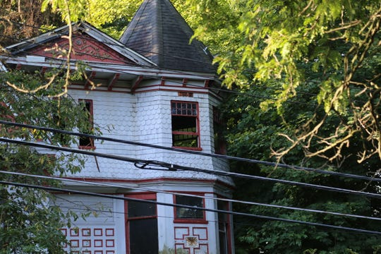 The property at 409 East Buffalo St. in Ithaca was closed off after a fatal fire on Monday.