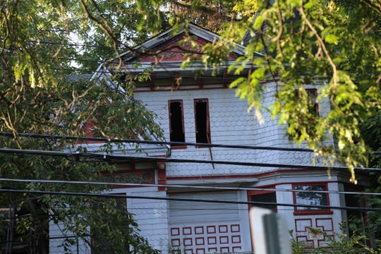 409 East Buffalo St. in Ithaca was closed off after a fatal fire on Monday, Sept. 10, 2019. The heavy fire was in the back of the house, but parts of the front exterior, like the windows, also showed damage.
