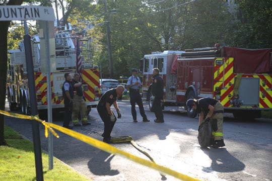 Firefighters remained at the scene Tuesday morning at 409 East Buffalo St. in Ithaca, after a fatal fire.