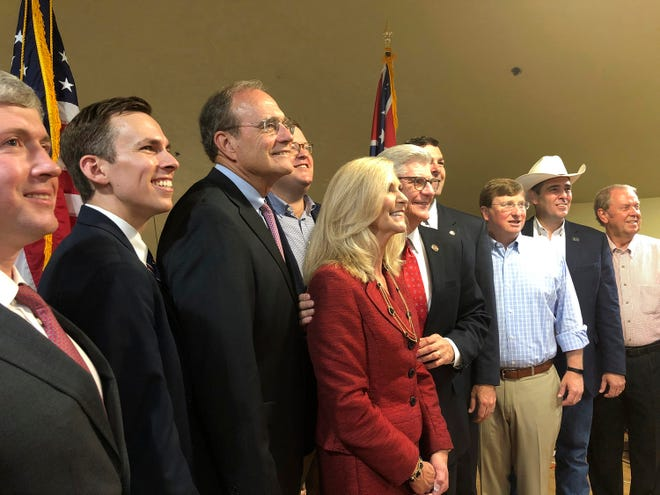 Mississippi Republican nominees for statewide offices pose with Gov. Phil Bryant, fifth right, and state GOP chairman Lucien Smith, fourth left, at a campaign event Monday, Sept. 9, 2019, in Madison, Miss. Pictured from left are treasurer nominee David McRae; Auditor Shad White; Secretary of State Delbert Hosemann, who is running for lieutenant governor; Smith in back row; Treasurer Lynn Fitch, who is running for attorney general; Bryant; state Sen. Michael Watson, who is running for secretary of state; Lt. Gov. Tate Reeves, who is running for governor; Agriculture Commissioner Andy Gipson; and Insurance Commisioner Mike Chaney. Bryant is term-limited.