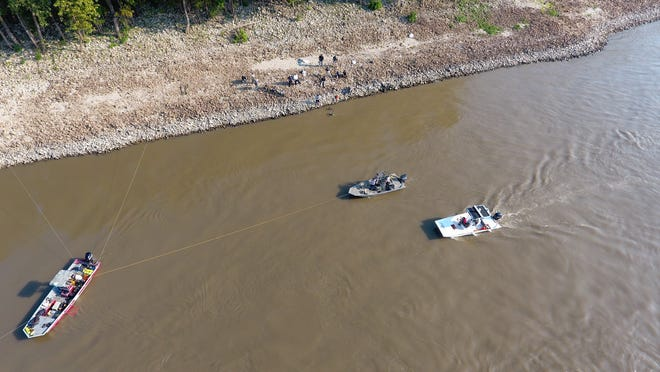 Authorities search the Mississippi River after an SUV with a woman and two children runs into the water