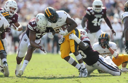 Mississippi State's Fletcher Adams (43) and Mississippi State's Kobe Jones (52) tackle Southern Mississippi's Kevin Perkins (33). Mississippi State and Southern Mississippi played in a college football game on Saturday, September 7, 2019 at Davis Wade Stadium in Starkville.