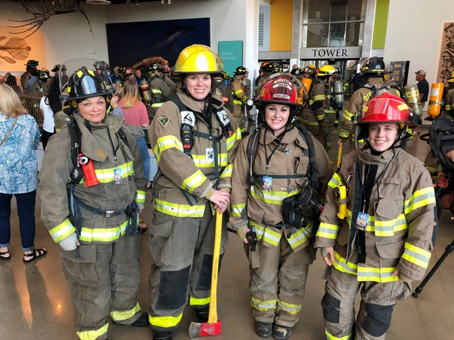 Jill Sheppard (Madison County Fire Department), Stephanie Haynes (Brazil Volunteer Fire Department), Christy Holdeman (Obion County Fire Department) and Bri Burg (Paris Landing Fire Department) were a few of the female firefighters who made the climb on Saturday.