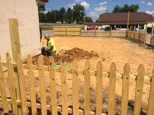 As Phillip Brinkley works on customizing the building, the fenced-in portion will allow for a play area for kids and a hammock garden.