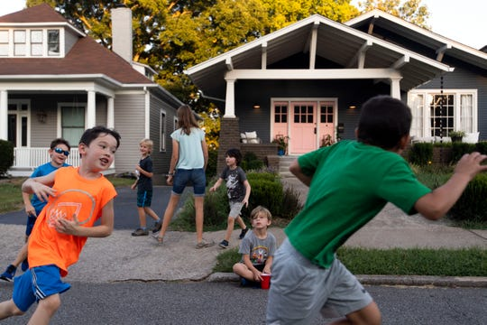 Children at play during Historic Fourth and Gill Neighborhood Organization's long table potluck on Luttrell St. on Sunday, September 8, 2019.