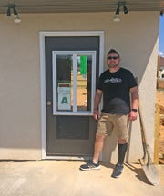 Besides his ministry, Michael Cox is working hard to make his coffee shop more convenient for the Powell community.
