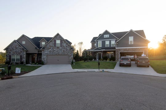 Keith Lambert, the former assistant chief of the UT Police Department, bought the house, at left, next to the Slowiks' home, at right. Lambert mistakenly walked into the Slowik's garage, drew his gun and yelled at them repeatedly to get out of his house.