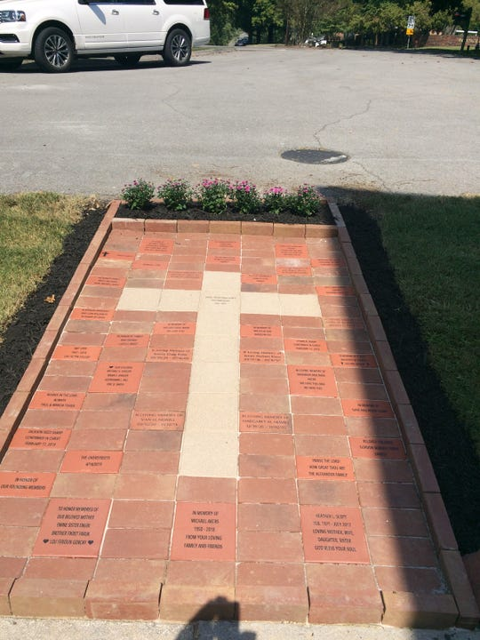 Bricks in front of Powell Presbyterian honor loved ones. A similar memorial at New Hope will be added.