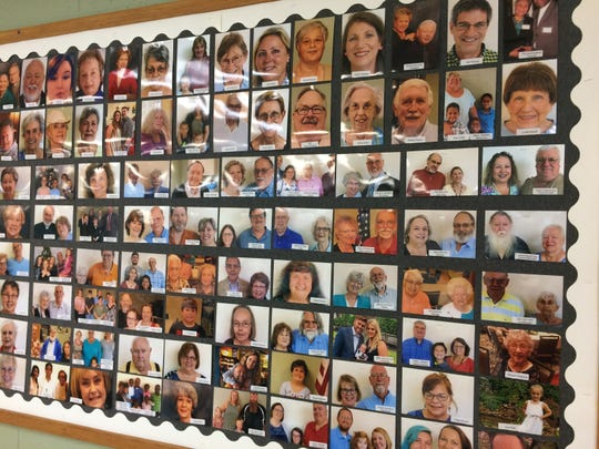 One way to help merge two congregations has been to display photos of everyone.